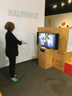 A curator plays Fruit Ninja on the Microsoft Kinect.