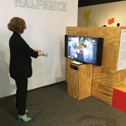 A curator plays Fruit Ninja on the Microsoft Kinect.