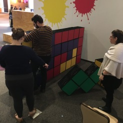 Playing tetris with colored milk crates.