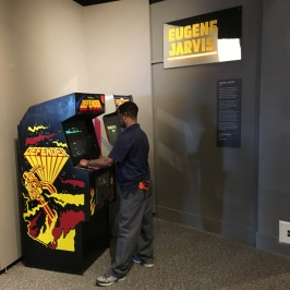 Playing an original Defender cabinet.